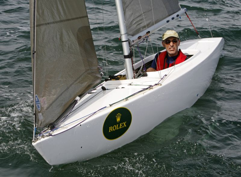 2.4 meters boat have a front-facing seat and hand-held controls to enable sailing of the boat without use of the lower body.